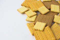 Biscuits carrés sur un fond blanc Il y a endroit pour un insc Photo stock