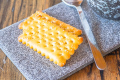 Biscuits on ceramic plate. Biscuits on ceramic plate background Royalty Free Stock Photos