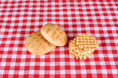 Biscuits on checkered cloth Royalty Free Stock Photos