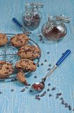 Biscuits and chocolate drops Stock Photos