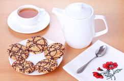 Biscuits with chocolate and peanut decoration Stock Photos