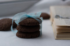 Biscuits. Chocolate biscuits with ribbon and book Royalty Free Stock Photography