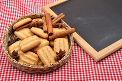 Biscuits for Christmas with cinnamon and anise near a blank blac Stock Photography