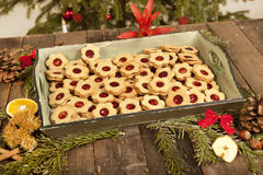 Biscuits and Christmas decoration Stock Photos