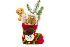Biscuits in a christmas sock isolated Stock Images