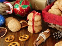Biscuits with cinnamon surrounded by Christmas attributes Stock Images