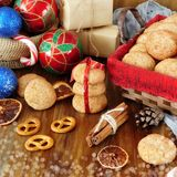 Biscuits with cinnamon surrounded by Christmas attributes Royalty Free Stock Images