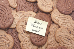 Biscuits with cocoa and chocolate with post-it. Biscuits with cocoa and chocolate shaving with post it note, lots of cakes overlapping with message Royalty Free Stock Photos