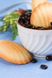 Biscuits and coffee beans on blue napkin Stock Photo