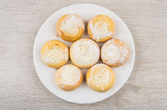 Biscuits with cottage cheese filling in white saucer on table. Biscuits with cottage cheese filling in white saucer on wooden table. Top view Stock Image
