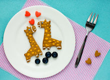 Biscuits créatifs pour des enfants sous forme de girafe Image stock