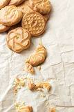 Biscuits  and crumbs on crumpled paper Royalty Free Stock Photo