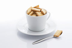 Biscuits in cup Royalty Free Stock Images