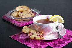 Biscuits and a cup of tea Stock Photo