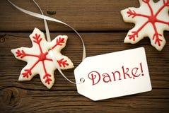 Biscuits d'étoile de Noël avec Danke Image stock