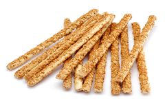 Biscuits de bâton de sésame sur le fond blanc images libres de droits