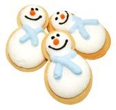 Biscuits de bonhomme de neige de Noël Photographie stock libre de droits
