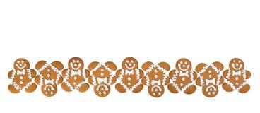 Biscuits de bonhomme en pain d'épice sur le blanc images stock