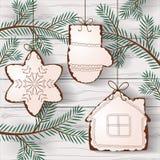 Biscuits de Noël accrochant sur les branches d'arbre illustration de vecteur