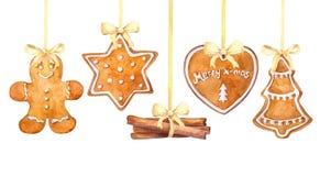 Biscuits de pain d'épice de Noël et bâtons de cannelle accrochant la frontière sur un fond blanc illustration libre de droits