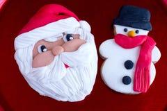 Biscuits de Santa Claus et de bonhomme de neige Image stock