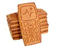 Biscuits de sucre dans un téléphone portable Images libres de droits