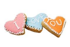 Biscuits de Valentine avec les mots je t'aime d'isolement sur le Ba blanc Photo libre de droits