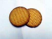 Biscuits digestifs de rond de blé entier d'isolement sur la terre arrière blanche photographie stock libre de droits
