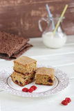 Biscuits with dried cherries. And a pitcher of milk on the table royalty free stock image