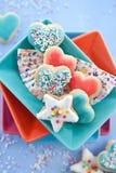 Biscuits en forme de coeur et en forme d'étoile Photographie stock libre de droits