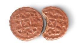 Biscuits entiers et mordus de chocolat se trouvant après Images stock