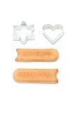 Biscuits et formes de traitement au four Photo stock