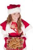 Biscuits et sourire de Mme Santa Image libre de droits