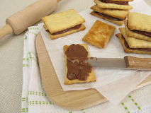 Biscuits filled with chocolate cream Stock Photography