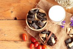 Biscuits filled with chocolate and fresh milk. Royalty Free Stock Photography