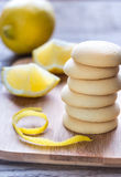 Biscuits filled with lemon cream on the wooden board Royalty Free Stock Photography