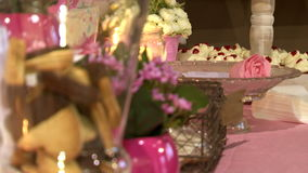 Biscuits Flowers and Candles 1. A set with chocolate biscuits, flowers, cake pops and candles stock video footage