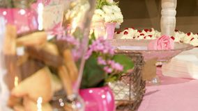 Biscuits Flowers and Candles Wedding Accessories. A set with chocolate biscuits, flowers, cake pops and candles stock video footage