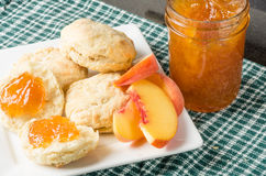 Biscuits and fresh peach jam Royalty Free Stock Images
