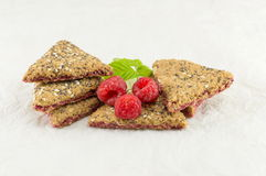 Biscuits with fresh raspberry fruit. Integral triangle shaped biscuits with fresh raspberry fruit Royalty Free Stock Image