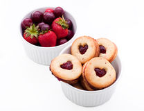Biscuits and fruit. In a bowl on a white background Stock Photography
