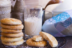 Biscuits with a glass of milk on tray. Stack of milk biscuits and milk in a glass Stock Photos