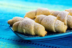 Biscuits with ground hazelnuts on blue ceramic plate Stock Image