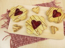 Biscuits with heart of raspberry jam Royalty Free Stock Images