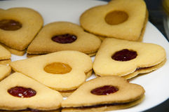 Biscuits with jam. Presentation of some round cookies and other heart-shaped Royalty Free Stock Images