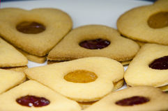 Biscuits with jam. Presentation of some round cookies and other heart-shaped Stock Image