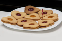 Biscuits with jam. Presentation of some round cookies and other heart-shaped Stock Images