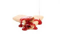 Biscuits with jam and red syrup. Royalty Free Stock Photo