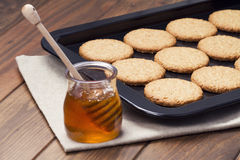 Biscuits and a jar of honey Stock Photography