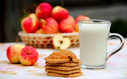 Biscuits and Milk. Biscuits with homemade apple jam and milk Stock Photo